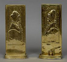 A pair of Arts & Crafts brass wall sconces Each repousse decorated with a b