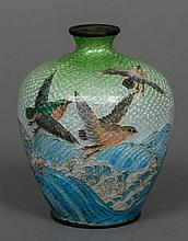 A small cloisonne vase  Decorated with birds above cresting waves.  9.5 cm