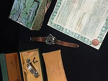 A boxed Rolex Oyster Perpetual Date Submariner Of typical form, with black