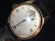 A gold Rolex Precision gentleman's wristwatch The silvered dial with Arabic