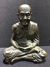 A Chinese bronze figure Modelled as a sage, seated cross legged.  28.5 cm h