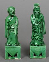 A pair of Chinese porcelain figures of a sage and his companion Both with a