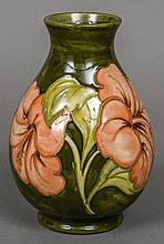 A Walter Moorcroft pottery baluster vase Decorated with the Peach Hibiscus