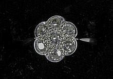 A diamond set 18 ct white gold and platinum daisy