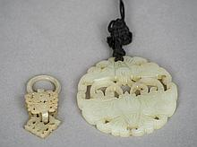 A Chinese carved jade bi disc Worked and pierced a