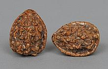 A pair of Chinese canton carved nuts Each profusel