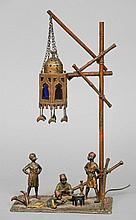 An Austrian cold painted bronze table lamp, in the