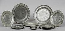 A quantity of pewter dishes Various dates, touch m