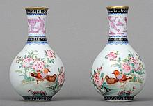 A pair of Chinese porcelain baluster vases Each de