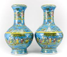 A pair of Chinese Polychrome Porcelain Figural Vases