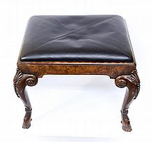 A 19th century English wooden bench or leg rest