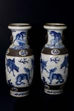 A pair of large Chinese porcelain dragons vases