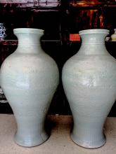 A large pair of celadon vases