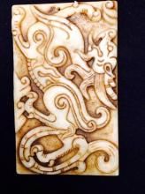 A White Jade Plaque with Carved Dragon