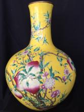 A famille rose porcelain nine peaches vase