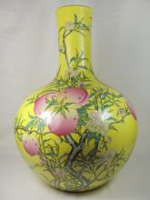 A yellow glazed famille rose porcelain flow nine peaches vase