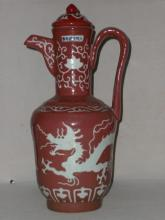 A Red-Glazed Porcelain Dragon Teapot