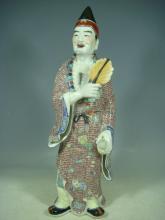 A Famille Rose Porcelain Jigong Statue