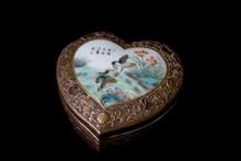 An enamelled hear-shaped box