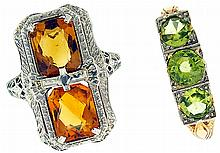Rings- 2 (Two), one with three peridot set in white and yellow gold, marked 14k, size 8 1/2, the other with two emerald cut citrine in a 14k white gold openwork setting, size 6, early 20th century