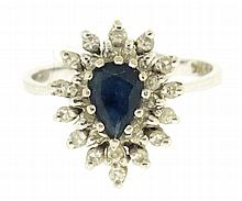 Ring, 14 karat white gold with pear shaped sapphire surrounded by 27 diamonds, size 6 1/2, 3.4g TW