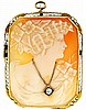 Cameo pin /pendant, carved shell portrait of a young woman in profile, wearing a diamond necklace, 14 karat yellow gold oblong frame with cut corners, 1 5/8