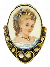 Portrait pin, oval porcelain plaque depicting a young woman in a blue dress, in a gold filled setting with pearls, plaque signed