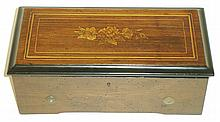 Switzerland, six inch cylinder music box with rosewood veneered top with line and decorative flower inlay, c1900