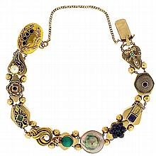Bracelet, 14 karat yellow gold, the hollow links of various shapes pierced and joined with a continuous chain, and separated by small gold beads, each link with decorative applied metalwork and set with cut and colored stones, a very well made and