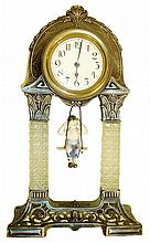 German mantel clock with bouncing doll pendulum, spelter case with deco styling and classical ornament and two decorative pressed glass columns, Arabic numeral paper dial, 30 hours, time only movement with bisque