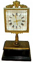 Jean Eugene Robert Houdin, Paris, fifth series mystery clock, ebonized rectangular ogee molded wooden base topped with a gilt brass platform, the center with short column supporting the square beveled glass dial with pierced brass hands, enclosed in