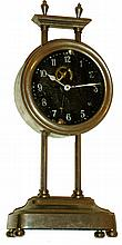 Gravity Clock, European, 30 hours, with exposed compound pendulum visible through the glass dial. Movement is in a nickel plated canister that is raised on toothed post to wind, c1922