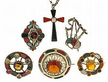 Scottish pebble jewelry -6 (Six) pieces, all set with polished stones including jasper, bloodstone, agate, and others, five brooches, one in bagpipe form, and a Celtic cross necklace with silver chain, late 19th - early 20th century