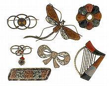 Scottish pebble brooches -7 (Seven), all set with polished stones including jasper, bloodstone, agate, granite, and others, the forms including a dragonfly, a harp, a wreath, and a bowknot, the remaining pins with pleasing geometry and color, the