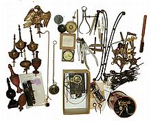 Clock and watch parts, plus books: assorted lot of small tools, hands, keys, two dollar watches, finials, side arms and early 19th century iron-plate banjo clock movement attributed to Paul Rogers of Berwick, Maine. Books include classics by Parsons
