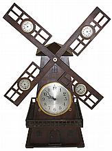 Globe Clock Co., USA., 8 days, time and strike, windmill novelty clock with wood case with 4 small auxiliary dials on vanes, Movement is German, c1925.