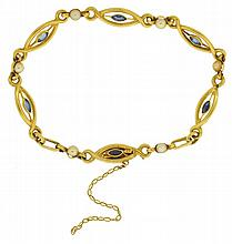 Bracelet, France, a very attractive design in 18 karat yellow gold and set with small marquis cut sapphires and pearls7 1/2