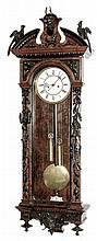 Lenzkirch, Germany, Vienna Regulator wall clock, 8 days, 2-wt, time and strike, weight driven movement marked with Lenzkirch hallmark in a mahogany and ebonized case with ornately detailed carvings in hunting motif including oak leaves, acorns,