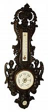 English, large ornate wheel barometer (mercury tube), thermometer and hygrometer, in a carved wooden case flanked by mermaids, with gesso coating and dark finish, c1875