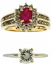 Rings, 2 (Two)- 14 karat yellow gold with an oval ruby surrounded by small diamonds, size 7, and one in 14 karat white gold set with a 1 carat cubic zirconia, size 5 3/4