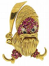 Pin, insane pirate with 18 karat yellow gold turban, beard, cutlass, and boots, his face set with rubies, sapphires and diamonds, and with ruby set pantaloons, 20th century, 1 7/8