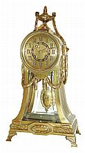 Lenzkirch, Germany, shelf clock, brass case with fluted, incurved sides and round top, decorated with laurel festoons and moldings, back and front set with beveled glasses, Roman numeral brass dial, brass hands, 8 days, time and strike, movement with
