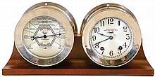 Clocks- 2 (Two) and a barometer: (1) Chelsea Clock Co., Boston, Mass., Quartz battery Ship strike ship's bell clock. c1997 (2) Seth Thomas Clock Co., Thomaston, Conn., 8 days, spring brass movement seven jeweled ship's bell clock in a heavy nickel