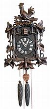 Clocks- 2 (Two) German Black Forest carved walnut 2 weight 30 hour cuckoo clocks; top rooster; fox and grapes; late 19th and early 20th centuries