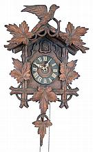 Clocks- 2 (Two) Cuckoo German Black Forest 30 hour 2 weight hanging clocks: (1) railway style with wooden plate movement, c1880; (2) with carved leaves and bird, cast metal plates; c1910
