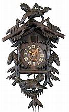 Cuckoo Clock, Black Forest, Germany, 30 hour carved dark-stained wood with two large birds with glass eyes, c1890