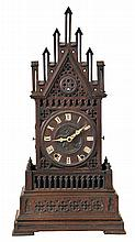 Shelf Cuckoo, in the Gothic style, oak architectural case with crenellated parapet and gable, the front and sides with pierced and carved blind fretwork with various foils, carved wooden dial with applied Roman numerals, carved bone hands, 50 hour