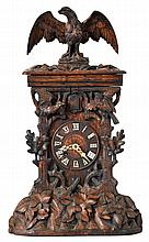 Shelf Cuckoo, carved oak case in the rustic style, the front with oak leaves and acorns, two birds, all surmounted by a large eagle, turned wooden dial with applied Roman numerals, carved bone hands, 8 day, brass time and strike with going barrels
