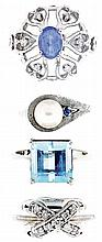Rings; 4 (Four): All white gold, the first 14 karat, with open work and set with tanzanite and white sapphires, size 7, the next also 14 karat and set with 9 small diamonds, size 6 1/2, the third in 14 karat, set with a 6mm pearl, and a small blue