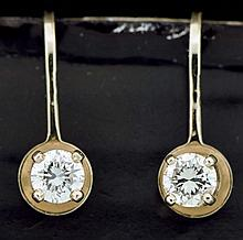 Earrings, 14 karat yellow gold, each set with a single diamond weighing approximately .2 carats, 3.0g TW, 20th century